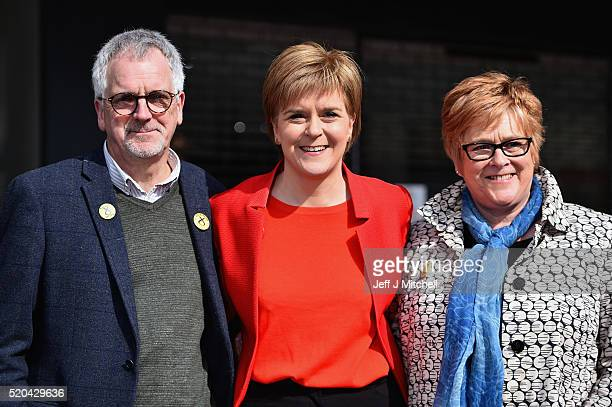 First Minister Nicola Sturgeon stands with her mother Joan and father Robin as she set out the SNP's commitments to older people in Scotland, during...