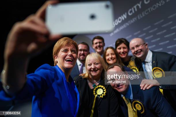 First Minister Nicola Sturgeon takes a selfie with some her newly elected MP's at the Glasgow count in the SECC on December 12 2019 in Glasgow...