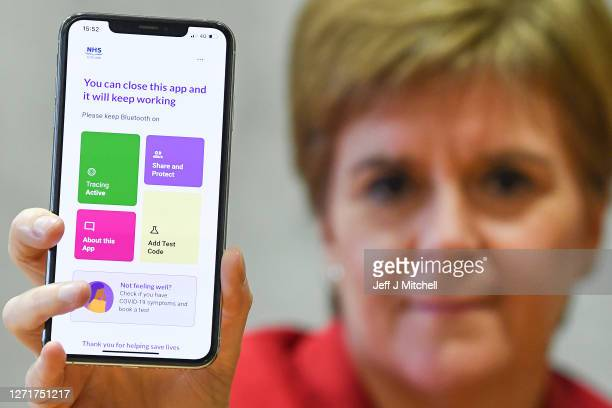 First Minister Nicola Sturgeon views the new Covid - 19 track and trace app on a phone at the Scottish Parliament on September 10, 2020 in Edinburgh,...
