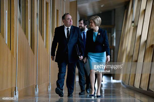 First Minister of Scotland Alex Salmond arrives with Nicola Sturgeon to take his last First Minister's Questions at the Scottish Parliament on...