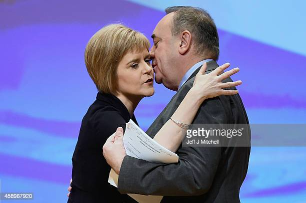 First Minister of Scotland Alex Salmond is kissed by Nicola Sturgeon before his last key note speech as party leader of the SNP at the partys annual...