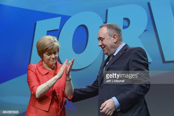 First Minister of Scotland Alex Salmond leader of the Scottish National Party reacts with Nicola Sturgeon after delivering his speech to delegates at...