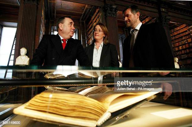 First Minister of Scotland Alex Salmond with Vice-Provost of Trinity Professor Ruth Byrne and Keeper of the Manuscripts Dr Bernard Meehan during his...