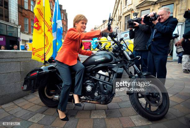 First Minister of Scotland and leader of the Scottish National Party Nicola Sturgeon MSP poses on a motorbike decorated with Scottish Saltires and...