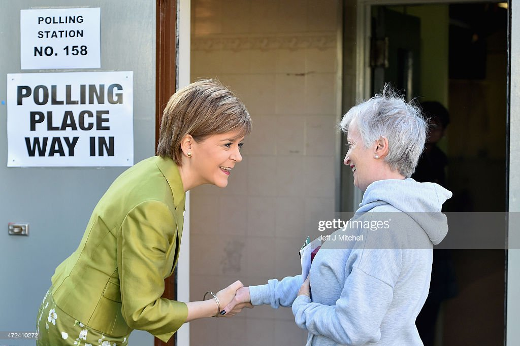 First Minister of Scotland and leader of the SNP Nicola Sturgeon greets a voter while at the polling station to vote on May 7, 2015 in Glasgow, Scotland. People across Scotland have begun casting their votes in the UK general election, with fifty nine Scottish seats up for grabs. The United Kingdom has gone to the polls to vote for a new government in one of the most closely fought General Elections in recent history.