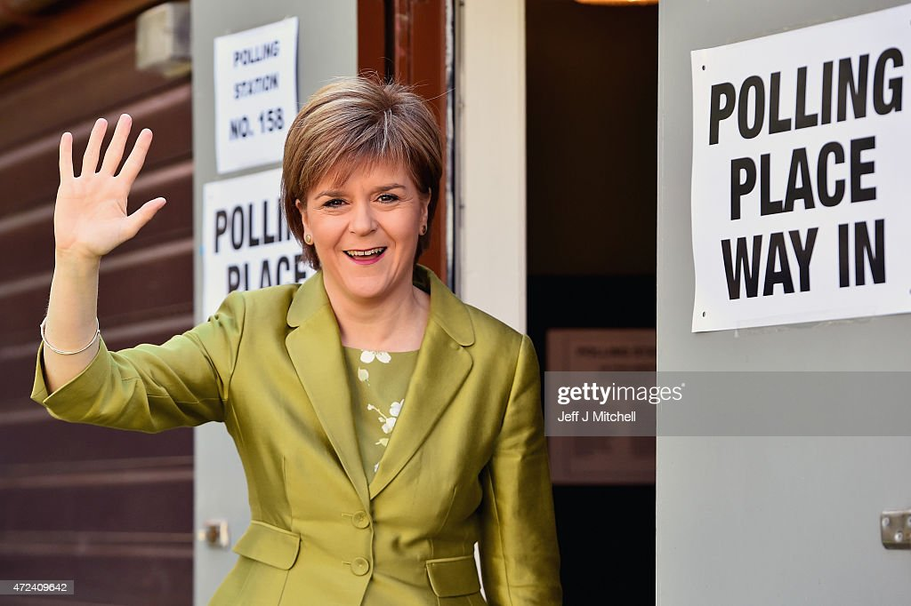 First Minister of Scotland and leader of the SNP Nicola Sturgeon, votes with her husband Peter Murrell on May 7, 2015 in Glasgow, Scotland. People across Scotland have begun casting their votes in the UK general election, with fifty nine Scottish seats up for grabs.