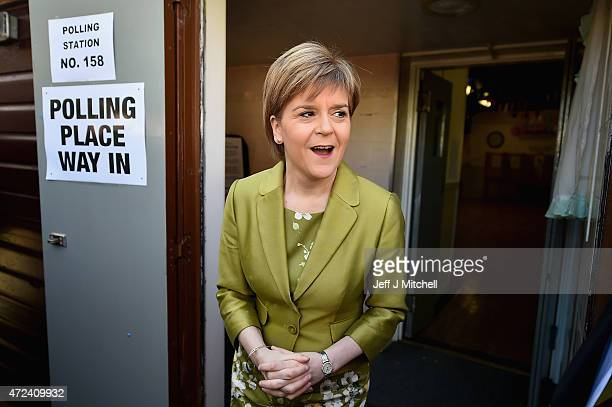 First Minister of Scotland and leader of the SNP Nicola Sturgeon votes with her husband Peter Murrell on May 7 2015 in Glasgow Scotland People across...