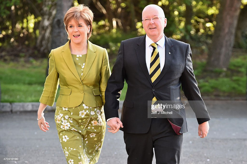 First Minister of Scotland and leader of the SNP Nicola Sturgeon, votes with her husband Peter Murrell on May 7, 2015 in Glasgow, Scotland. People across Scotland have begun casting their votes in the UK general election, with fifty nine Scottish seats up for grabs. The United Kingdom has gone to the polls to vote for a new government in one of the most closely fought General Elections in recent history. With the result too close to call it is anticipated that there will be no overall clear majority winner and a coalition government will have to be formed once again.