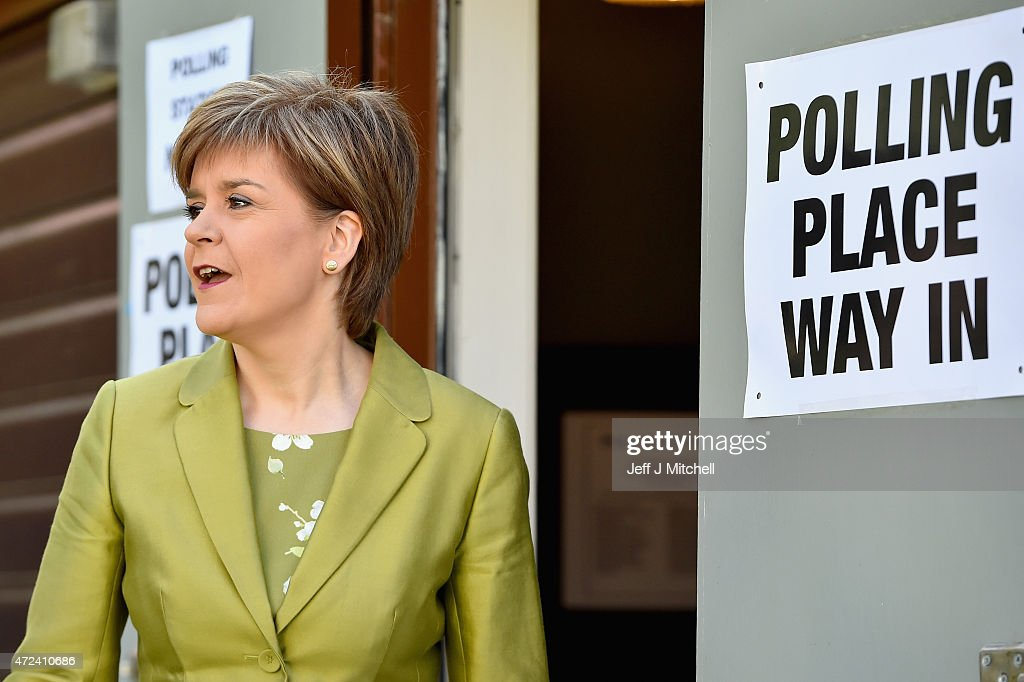 First Minister of Scotland and leader of the SNP Nicola Sturgeon, votes with her husband Peter Murrell on May 7, 2015 in Glasgow, Scotland. People across Scotland have begun casting their votes in the UK general election, with fifty nine Scottish seats up for grabs. The United Kingdom has gone to the polls to vote for a new government in one of the most closely fought General Elections in recent history.