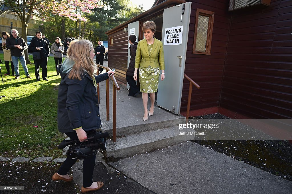 First Minister of Scotland and leader of the SNP Nicola Sturgeon, leaves after voting with her husband Peter Murrell on May 7, 2015 in Glasgow, Scotland. People across Scotland have begun casting their votes in the UK general election, with fifty nine Scottish seats up for grabs. The United Kingdom has gone to the polls to vote for a new government in one of the most closely fought General Elections in recent history.