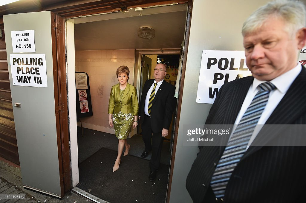 First Minister of Scotland and leader of the SNP Nicola Sturgeon exits after voting with her husband Peter Murrell on May 7, 2015 in Glasgow, Scotland. People across Scotland have begun casting their votes in the UK general election, with fifty nine Scottish seats up for grabs. The United Kingdom has gone to the polls to vote for a new government in one of the most closely fought General Elections in recent history.