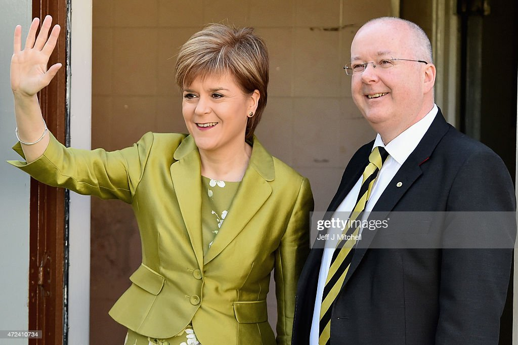 First Minister of Scotland and leader of the SNP Nicola Sturgeon waves after voting with her husband Peter Murrell on May 7, 2015 in Glasgow, Scotland. People across Scotland have begun casting their votes in the UK general election, with fifty nine Scottish seats up for grabs. The United Kingdom has gone to the polls to vote for a new government in one of the most closely fought General Elections in recent history.