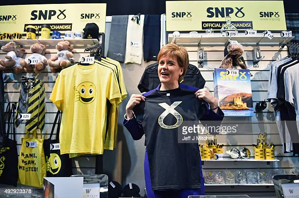 First Minister of Scotland and SNP leader Nicola Sturgeon visits a stall on day two of the 81st SNP annual conference at the Aberdeen Exhibition and...
