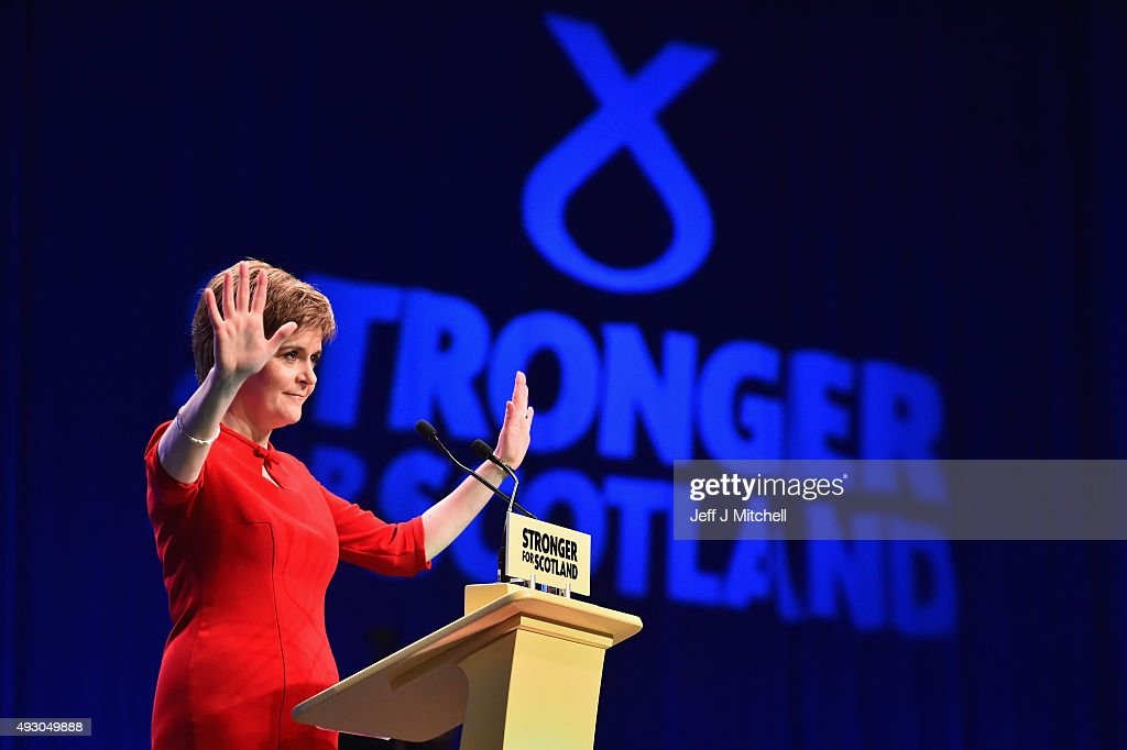 First Minister of Scotland Nicola Sturgeon acknowledges applause before her keynote speech at the 81st annual SNP conference at the Aberdeen Exhibition and Conference Centre on October 17, 2015 in Aberdeen, Scotland. During her address to delegates, Nicola Sturgeon announced a pledge to build a new network of NHS treatment centres and more financial support for carers if the SNP wins next year's Holyrood elections.