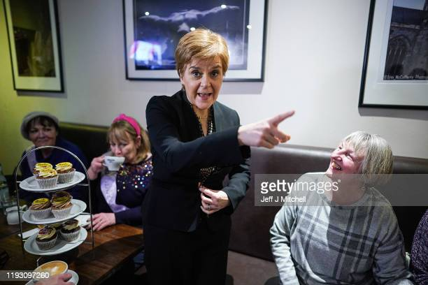 First Minister of Scotland Nicola Sturgeon and SNP general election candidate Mhairi Black campaign at Bianco E Nero on December 10, 2019 in Paisley,...