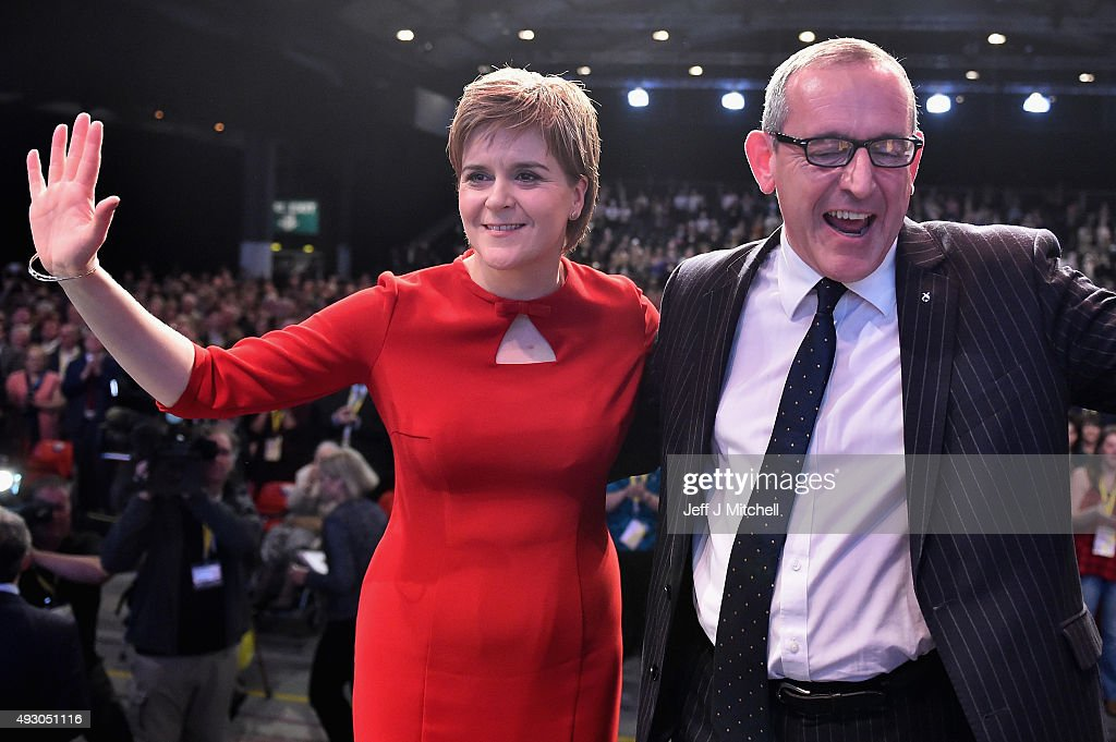 First Minister of Scotland Nicola Sturgeon and Stewart Hosie MP deputy leader acknowledge applause following the SNP leader's keynote speech during the 81st annual SNP conference at the Aberdeen Exhibition and Conference Centre on October 17, 2015 in Aberdeen, Scotland. During her address to delegates, Nicola Sturgeon announced a pledge to build a new network of NHS treatment centres and more financial support for carers of the SNP wins next year's Holyrood elections.