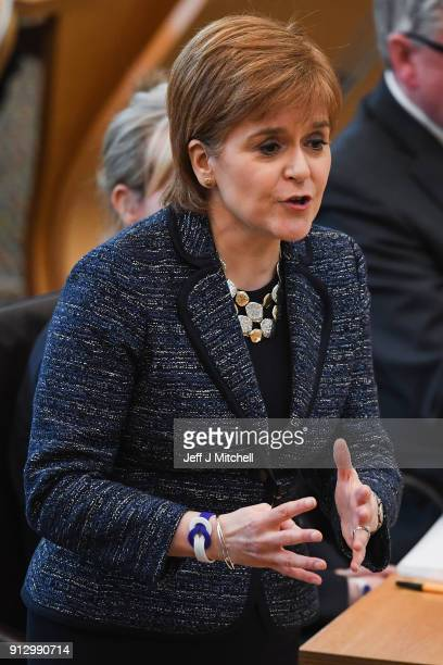 First Minister of Scotland Nicola Sturgeon answers questions during first ministers questions in the Scottish Parliament on February 1 2018 in...