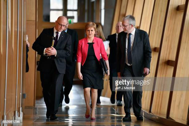 First Minister of Scotland Nicola Sturgeon arrives for First Minister's Questions with deputy John Swinney and Brexit minister Mike Russell inside...
