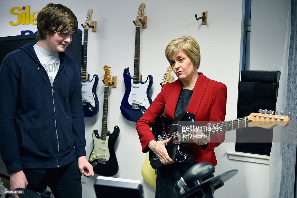 First Minister of Scotland Nicola Sturgeon, holds a guitar during a visit to The Kabin community learning centre on November 26, 2014 in Loanhead, Scotland. The First Minister will announce her first Scottish Government's legislative programme for 2014/15 at the Scottish Parliament today.