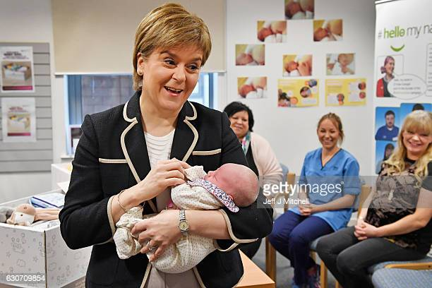 First Minister of Scotland Nicola Sturgeon holds newly born Libby Mellor as she gives out Scotland's first baby boxes at Clackmannanshire Community...