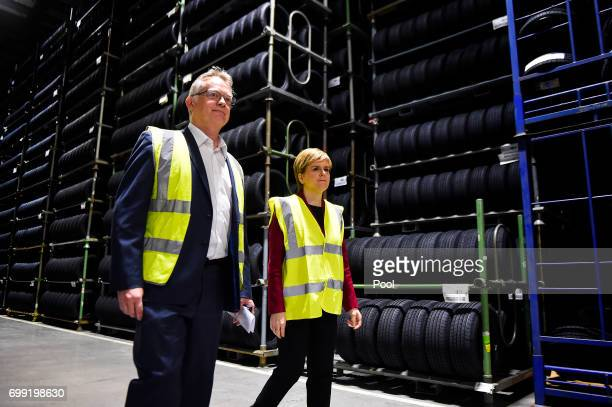 First Minister of Scotland Nicola Sturgeon is shown around by manager John Reid during a visit to the Michelin Tyre factory on June 21 2017 in Dundee...