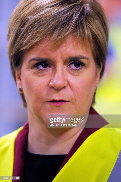First Minister of Scotland Nicola Sturgeon meets apprentices during a visit to the Michelin Tyre factory in Dundee Scotland on June 21 2017 / AFP...