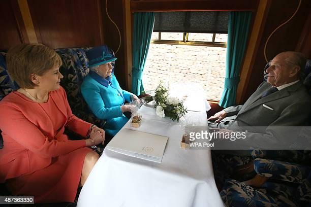 First Minister of Scotland Nicola Sturgeon, Queen Elizabeth II and Prince Philip, Duke of Edinburgh on board the steam locomotive 'Union of South...