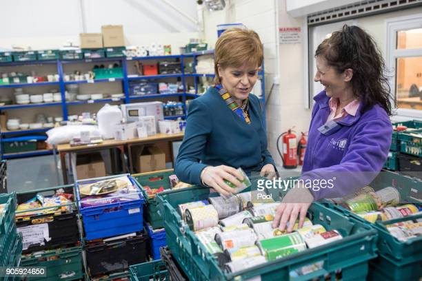 First Minister of Scotland Nicola Sturgeon speaks with volunteer Mary McBride as she visits the Start Up Stirling Food Bank on January 17 2017 in...