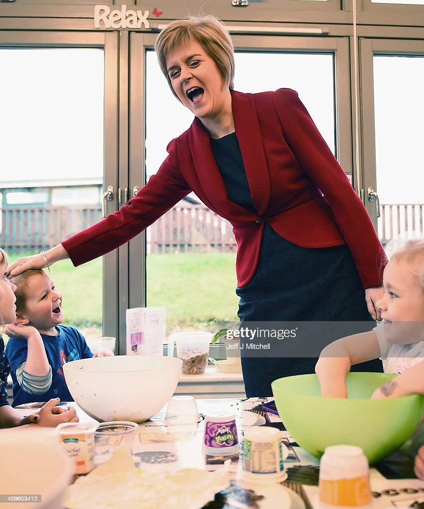 First Minister of Scotland Nicola Sturgeon, talks with four year old Killian Prokop as he makes bird feeders during a visit to The Kabin community learning centre on November 26, 2014 in Loanhead, Scotland. The First Minister will announce her first Scottish Government's legislative programme for 2014/15 at the Scottish Parliament today.