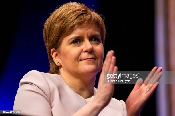 First Minister of Scotland Nicola Sturgeon watches Adam Price leader of Plaid Cymru makes his keynote speech at the 84th annual SNP conference at the...