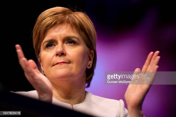 First Minister of Scotland Nicola Sturgeon watches Keith Brown MSP Depute Leader of the SNP make his keynote speech at the 84th annual SNP conference...