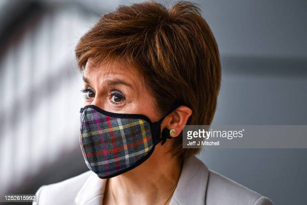 First Minister of Scotland Nicola Sturgeon wears a Tartan face mask as she visits New Look at Ford Kinaird Retail Park on June 26, 2020 in...