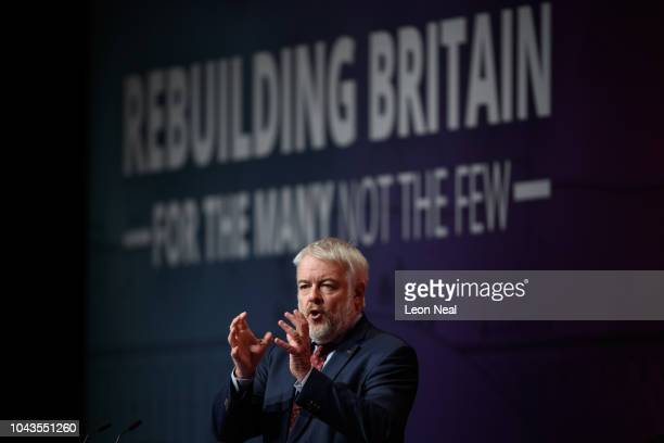 First Minister of Wales Carwyn Jones addreses delegates in the Exhibition Centre Liverpool during day two of the annual Labour Party conference on...