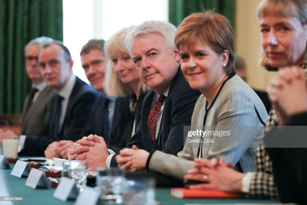 First Minister of Wales, Carwyn Jones (3R) and Scotland's First Minister Nicola Sturgeon (2R) attend a meeting of the Joint Ministerial Committee, chaired by Britain's Prime Minister Theresa May at 10 Downing Street in central London on March 14, 2018. / AFP PHOTO / Daniel LEAL