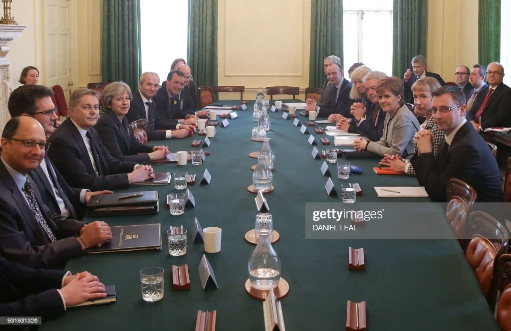 First Minister of Wales, Carwyn Jones (CL-R) and Scotland's First Minister Nicola Sturgeon (CR-R) attend a meeting of the Joint Ministerial Committee, chaired by Britain's Prime Minister Theresa May (C-L)at 10 Downing Street in central London on March 14, 2018. / AFP PHOTO / Daniel LEAL