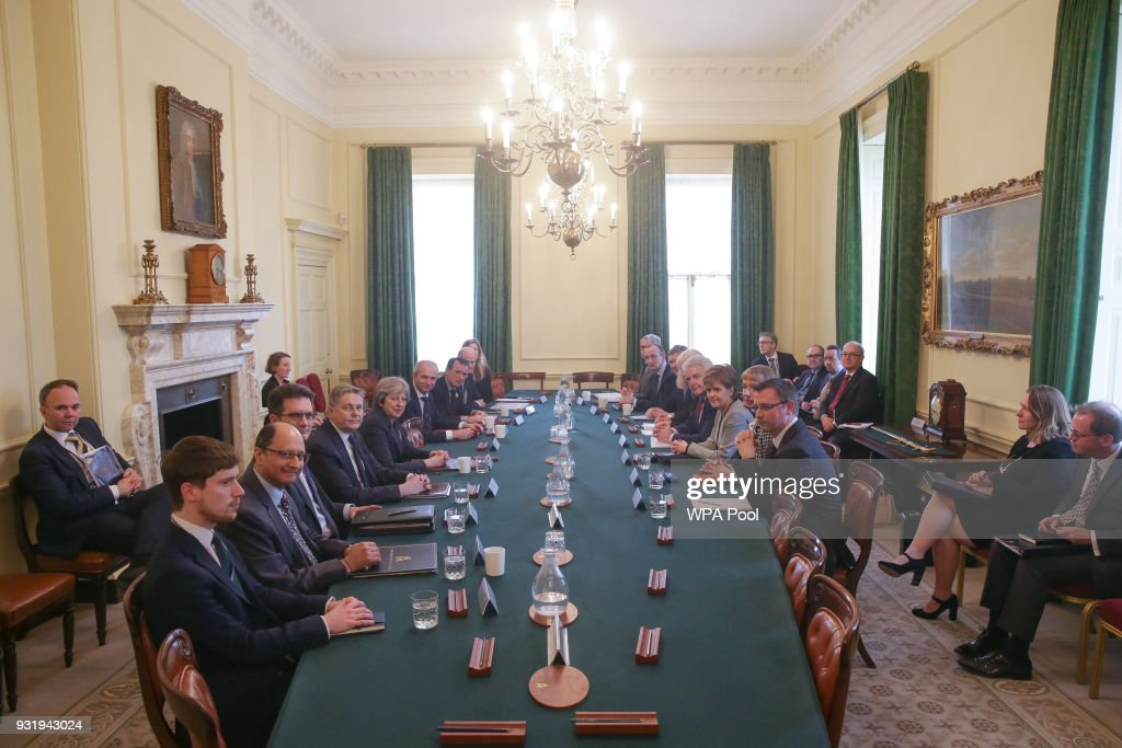 First Minister of Wales, Carwyn Jones (4th R) and Scotland's First Minister Nicola Sturgeon (CR) attend a meeting of the Joint Ministerial Committee, chaired by Britain's Prime Minister Theresa (C,L) May at 10 Downing Street on March 14, 2018 in London, England.
