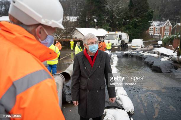 First Minister of Wales Mark Drakeford visits the scene of flooding in Skewen and speaks to workers from the Coal Board on January 24, 2021 in Neath...