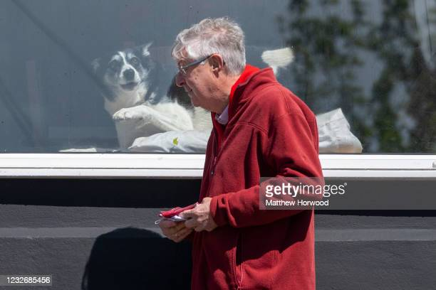 First Minister of Wales Mark Drakeford walks past a house with a dog in the window on May 4, 2021 in Porth, Wales. The next Senedd election is due to...