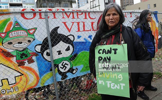 First Nation aboriginal Rose Henry who claims to be homeless protests outside the newly opened Olympic Tent Village which will house the homeless in...