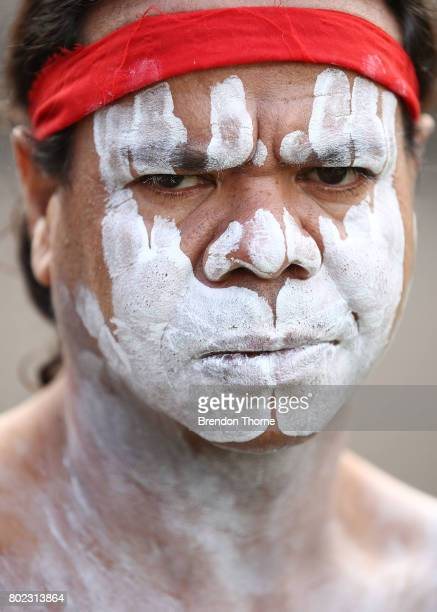 First Nation men dressed in traditional attire look on at Government House on June 28 2017 in Sydney Australia The flags will fly permanently...