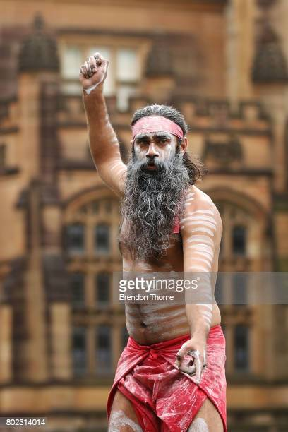 First Nation men dressed in traditional attire take part in a ceremonial performance at Government House on June 28 2017 in Sydney Australia The...