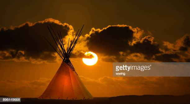 first nation teepee and autumn sunset - indigenous culture stock pictures, royalty-free photos & images