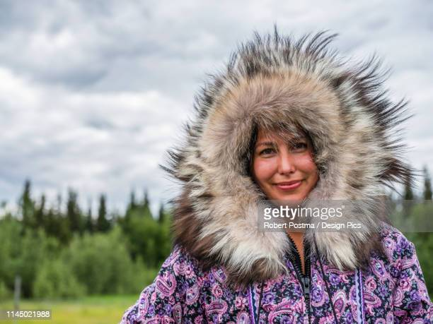 first nation woman dressed in handmade traditional coat - first nations stock pictures, royalty-free photos & images