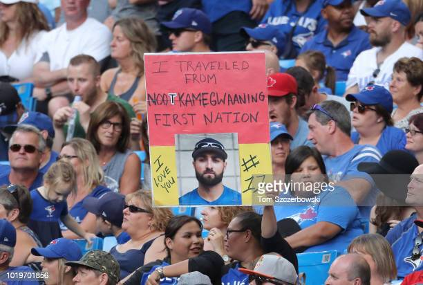 First Nations fan holds up a sign proclaiming her admiration for Kevin Pillar of the Toronto Blue Jays during MLB game action against the Tampa Bay...