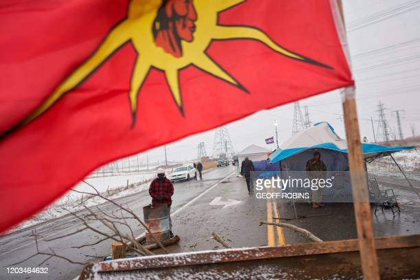 First Nations protestors man a barricade on Highway 6 near Caledonia Ontario which the protestors set up in support of the Wet'suwet'en hereditary...