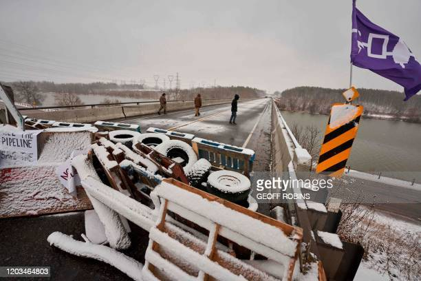First Nations protestors walk on a bridge past their barricade on Highway 6 near Caledonia Ontario which the protestors set up in support of the...