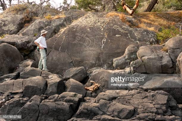 First Nations rock art petroglyph East Sooke Regional Park rain forest hiker Vancouver Island British Columbia