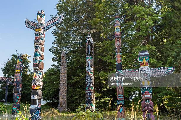 first nations totem poles, stanley park, vancouver - totem pole stock photos and pictures
