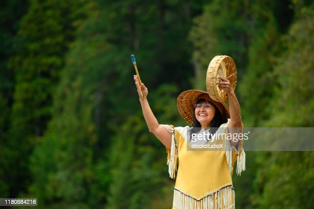 first nations woman performing a welcome song - first nations stock pictures, royalty-free photos & images