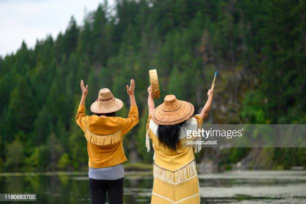 first nations women in traditional clothing - first nations stock pictures, royalty-free photos & images